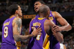 Andrew Bynum is held back by Andrew Bynum and Matt Barnes.JPG