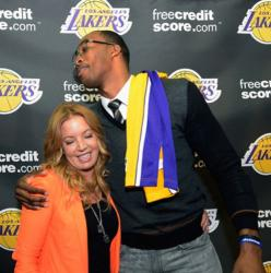 New Laker Dwight Howard puts his arm around Jeanie Buss.JPG