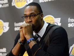 Dwight Howard in glasses contemplates a question during his Lakers press conference.JPG