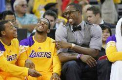 Dwight Howard has a laugh with several Laker players on the bench.JPG