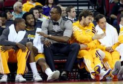 Dwight Howard in gray vest sits on Laker bench talking to Jordan Hill.JPG