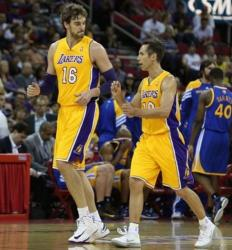 Steve Nash and Pau Gasol on the court in Laker gold home jersey.JPG