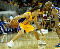 Steve Nash looks to put a move on Jarrett Jack.JPG