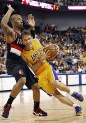 Steve Nash is bodied up by a Trailblazer.JPG