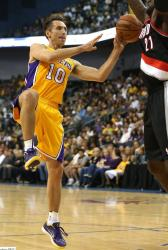 Steve Nash draws the defender and dishes the ball vs the Blazers.JPG