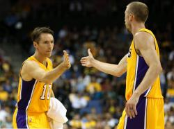 Steve Nash high-fives Steve Blake.JPG