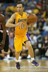 Steve Nash on the move pushing the ball as a Laker.JPG