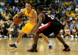 Steve Nash handles the ball sizing up the Portland defender.JPG