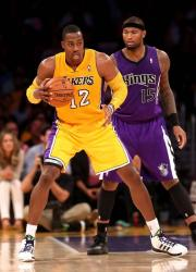 Dwight Howard has the ball in the Laker home jersey vs Demarcus Cousins.JPG