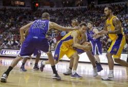 Steve Nash looks to throw a bounce pass vs the Kings.JPG
