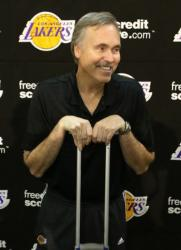 New Laker head coach Mike D'Antoni smiles as he puts both hands on a crutch.JPG