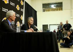 Mike D'Antoni sits next ot Mitch Kupchak during his introduction press conference.JPG