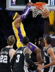 Dwight Howard slam dunk as Tiago Splitter Stephen Jackson and Tim Duncan watch.JPG