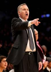 Laker head coach Mike D'Antoni points in a black jacket and pants.JPG