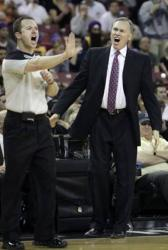 Laker head coach Mike D'Antoni yells as a referee makes a call.JPG