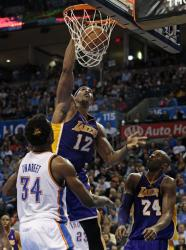 Dwight Howard dunks past Thabeet as Kobe Bryant watches.JPG