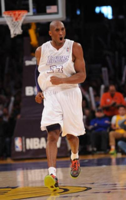 836bf0829e8 ... Kobe Bryant wearing Lakers Christmas Jersey pumps his fist.