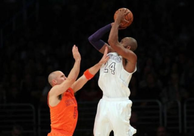 511306e320f Kobe Bryant in the white Laker Christmas Jersey elevates and shoots over  Jason Kidd.JPG