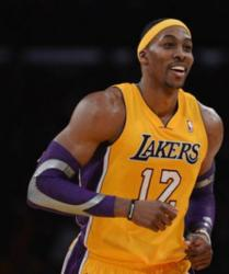 Dwight Howard smiles in a Laker home jersey with purple arm sleeves.JPG