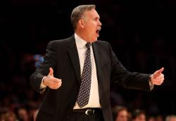 Mike D'Antoni gestures with both hands during a Laker home game.JPG
