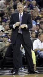 Mike D'Antoni smiles and points his index fingers.JPG