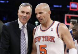 Laker head coach Mike D'Antoni has a friendly chat with Jason Kidd.JPG