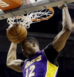 Dwight Howard dunks closes his eyes as the ball bounces off his head.JPG