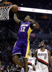 Dwight Howard one handed dunk past Lamarcus Aldridge in Portland.JPG