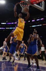 Dwight Howard 2 handed power slam dunk against the Warriors.JPG
