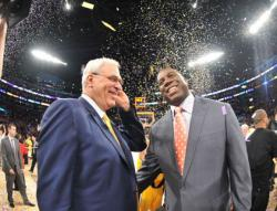 Magic Johnson smiles standing next to Phil Jackson as confetti fall at Staples Center.JPG