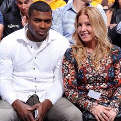 Jeanie Buss with Yasiel Puig at Laker game opening night 2013.JPG