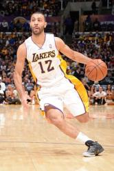 Kendall Marshall in Laker home jersey drives to the basket.JPG