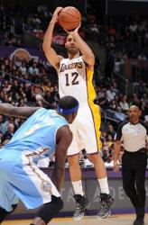 Kendall Marshall elevates for a jumper over Ty Lawson.JPG