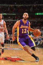 Kendall Marshall dribbles towards the basket vs the Bulls.JPG