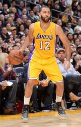 Kendall Marshall handles the ball in Laker home jersey.JPG