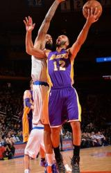 Kendall Marshall tries to shoot over Tyson Chandler in New York.JPG