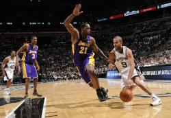 Josh Powell tries to stop Tony Parker.jpg