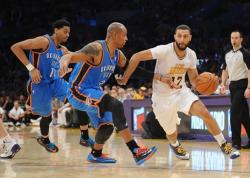 Kendall Marshall drives past Caron Butler.JPG