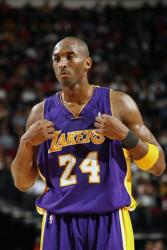 Kobe Bryant tugs at his Laker road jersey with game face on