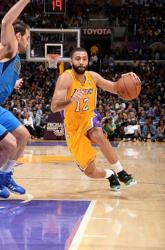 Kendall Marshall drives left against Jose Calderon.JPG