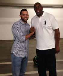 Magic Johnson shakes hands with Jordan Farmar.JPG