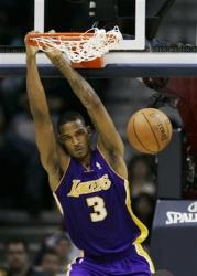 Trevor Ariza dunks and hangs on the rim.jpg