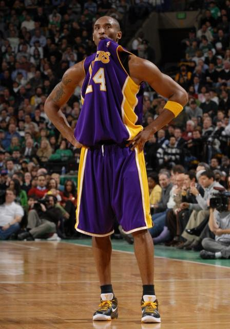 check out 0f5a4 ae079 Kobe Bryant bites at his Laker road jersey.jpg
