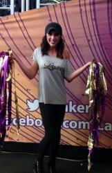 Laker Girl Kaela in Gray Shirt holding Pom Pom Streamers.JPG