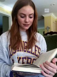Redhead Laker Girl Lizzi in Lakers Sweater Reading a Book