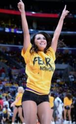 Latina Laker Girl in Fear Nothing Gold Shirt Jumping