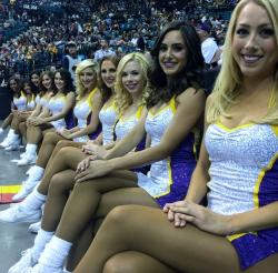Laker Girls 2015 in Silver and Purple Short Dresses Sit Courtside Smiling.JPG