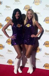 Two 2015 Laker Girls in Glittery Purple Dress and High Boots.JPG
