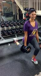 Smiling Hispanic Laker Girl Working Out with Free Weights
