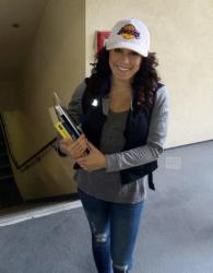 Cute Laker Girl Raquel in White Lakers Hat and Jeans Holding College Books.JPG
